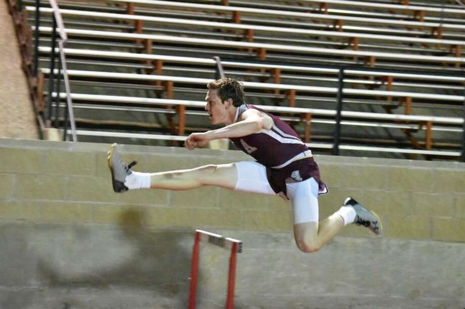 Konnor Hoerman runs through hurdles at a track meet last week. He placed first in the 110 Meter Hurdles at the district track meet on Wednesday. Photo: Courtesy Photo/Crystal Cortez