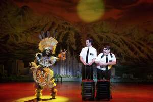 """Monica L. Patton, left, with Kevin Clay and Connor Peirson in a scene from """"The Book of Mormon."""""""