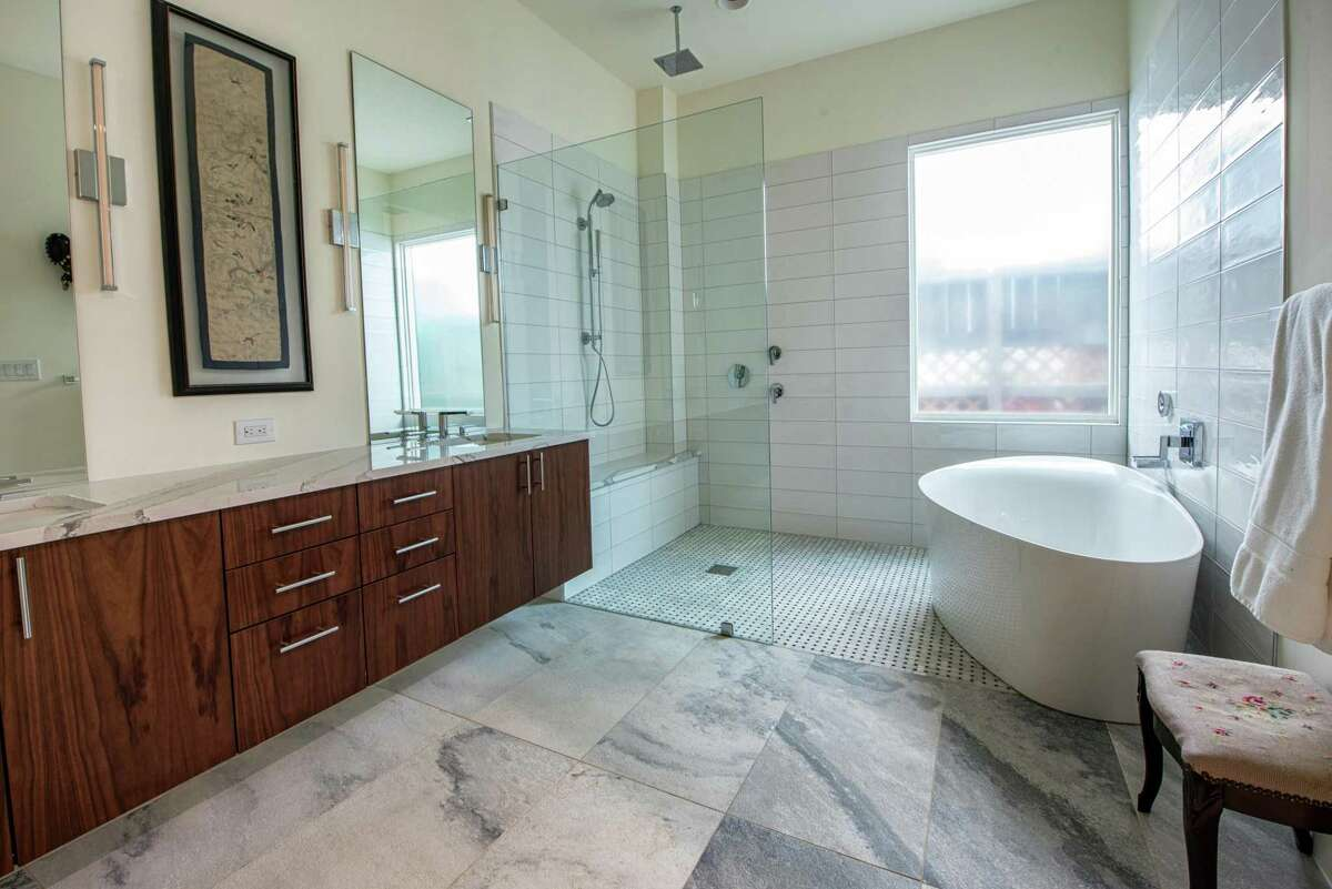King's master bath has leathered, honed tile flooring with a classic basketweave tile in the wet room.