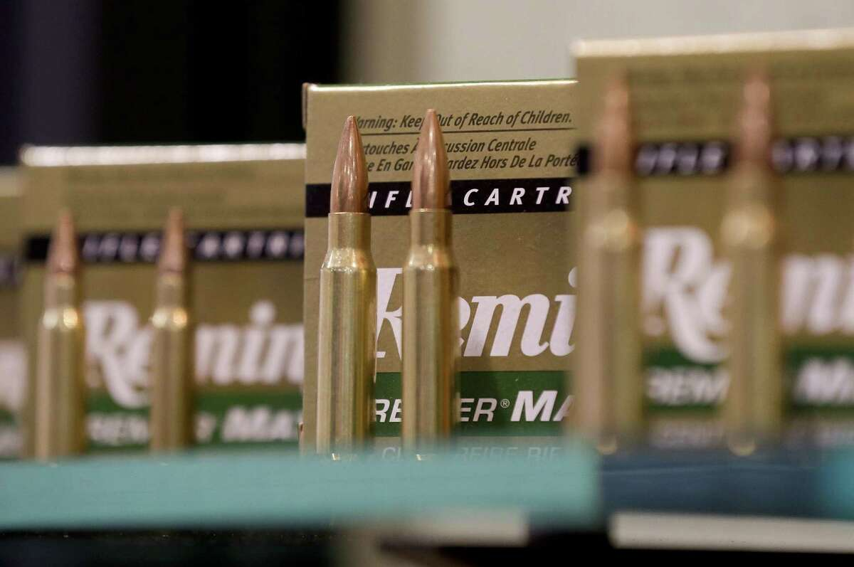 FILE - In this Tuesday, Jan. 15, 2013 file photo, Remington rifle cartridges are displayed at the 35th annual SHOT Show in Las Vegas. U.S. gun maker Remington Outdoor Company has filed for bankruptcy protection after months of financial problems, falling sales and lawsuits tied to the Sandy Hook Elementary School massacre. Records from the bankruptcy court of the district of Delaware show that the company filed late Sunday, March 25, 2018. (AP Photo/Julie Jacobson, File)
