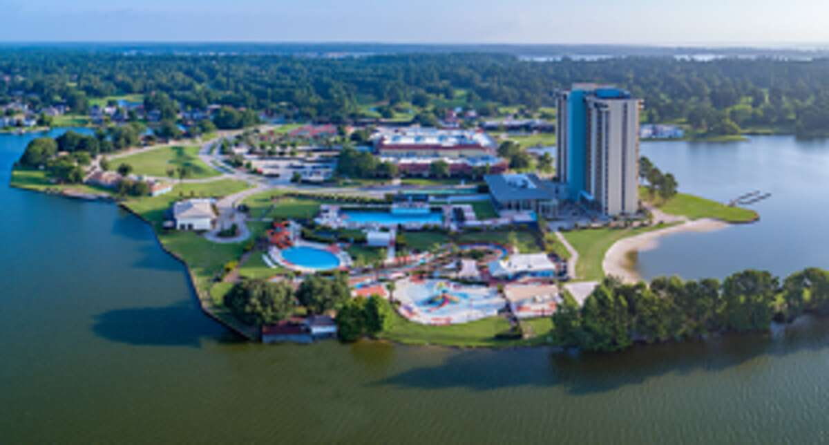FILE - An undated rendering of the upcoming Margaritaville Resort that will open along Lake Conroe in the third quarter of 2020. Interstate Management Co., the resort's owner, announced it will lay off 241 workers while they develop the space.