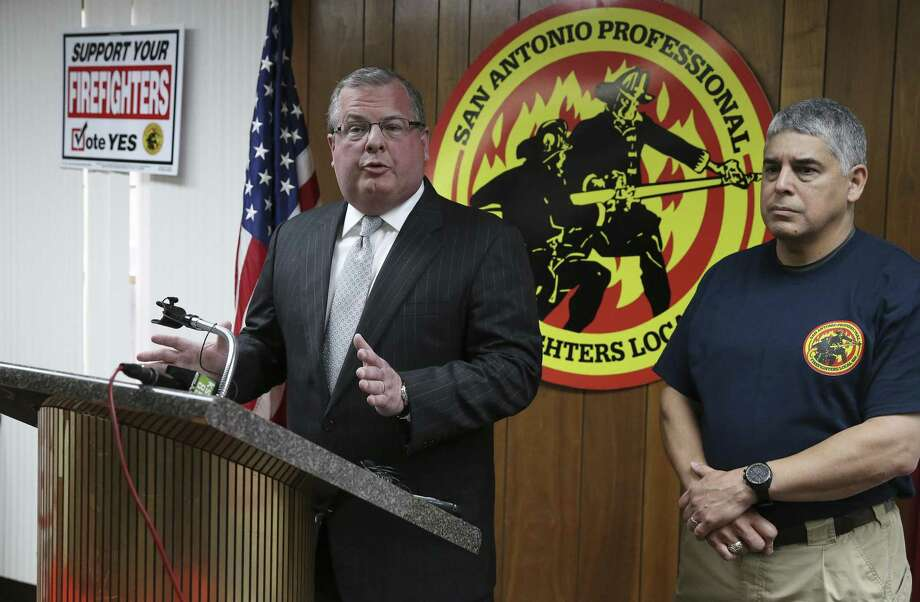 Officials from the San Antonio Firefighters Union, Ricky Poole (left) and Mark Black, hold a press conference on Thursday, Apr. 4, 2019 to plead with the city and with Mayor Ron Nirenberg for a 15-day extension at the negotiation table before the current deadline ends Monday and binding arbitration occurs for both parties to come to a contract resolution but has been at an impasse. (Kin Man Hui/San Antonio Express-News) Photo: Kin Man Hui, Staff / Staff Photographer / ©2019 San Antonio Express-News