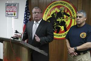 Officials from the San Antonio Firefighters Union, Ricky Poole (left) and Mark Black, hold a press conference on Thursday, Apr. 4, 2019 to plead with the city and with Mayor Ron Nirenberg for a 15-day extension at the negotiation table before the current deadline ends Monday and binding arbitration occurs for both parties to come to a contract resolution but has been at an impasse. (Kin Man Hui/San Antonio Express-News)