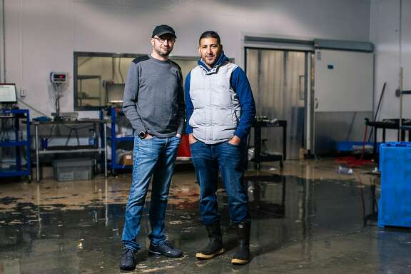 Four Star Seafood co-founders Adrian Hoffman, left, and Ismael Macias stand for a portrait together at their company's new 10,000-square-foot facility in San Francisco, Calif. on Wednesday, April 3, 2019.