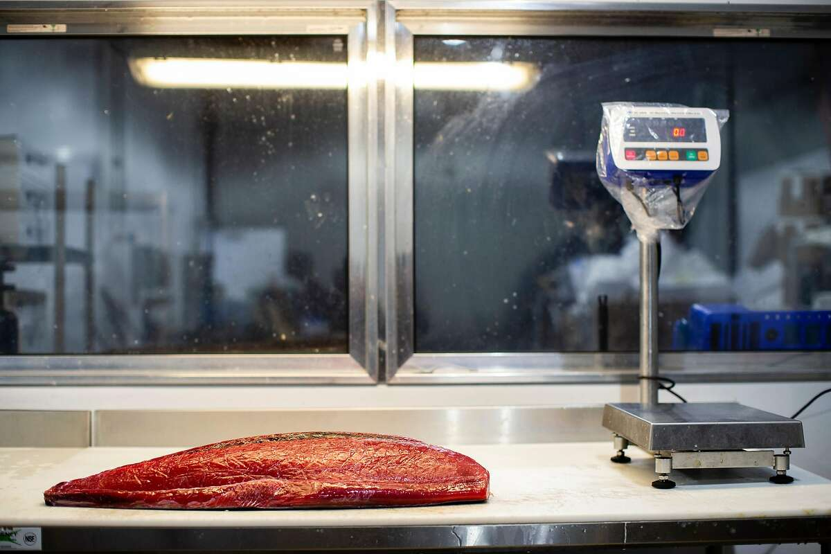 A tuna fillet rests on a table prior to be portioned for various restaurants at Four Star Seafood in San Francisco, Calif. on Wednesday, April 3, 2019.