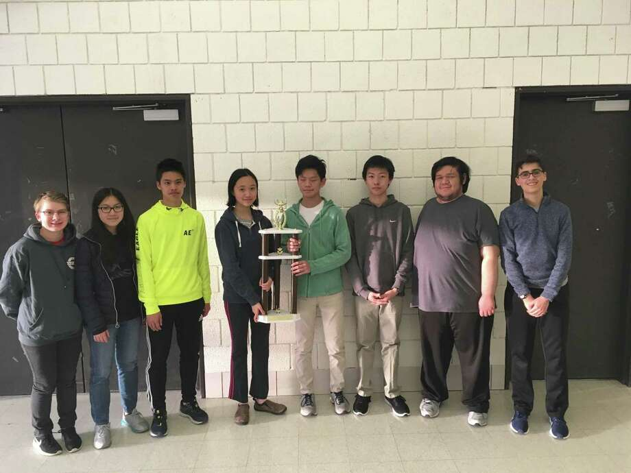 GHS math team members pose with their first place trophy, their fifth consecutive first place and their 10th in 11 years. Members include: Derrick Xiong, Jovita Li, Kyle Xiong, Zachary Wang, Zachary Tanenbaum, Sam Florin, Iris Shi and Skyler McDonnell. Photo: Contributed