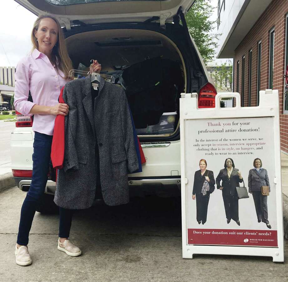 Rachel Rosson collected donations at the Greenwood King Properties Dress for Success/One Suit Week event held March 22-29.