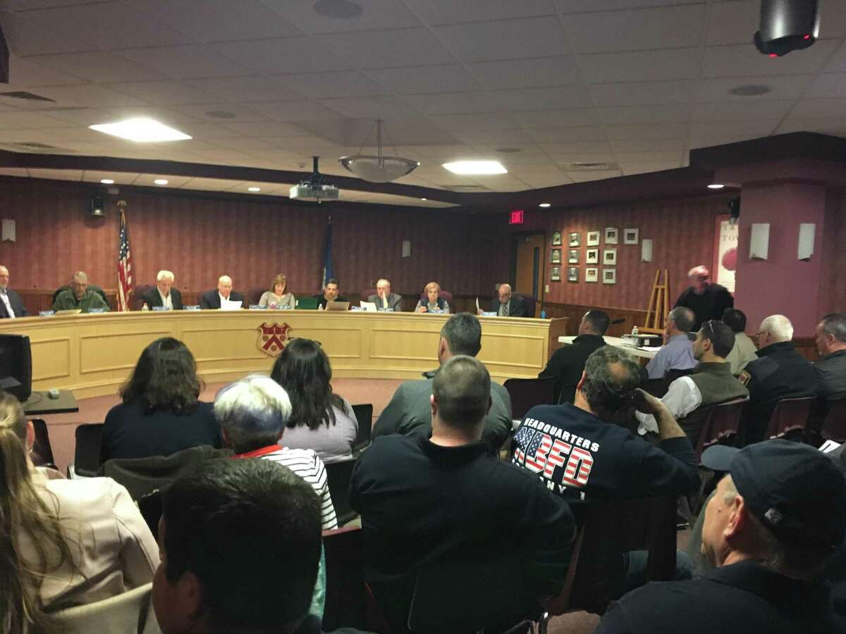 In this file photo, members of the North Branford Town Council sit in their chambers on April 4, 2019. At the front of the room, councilors from left: Alfred Rose, Anthony Candelora, Robert Viglione, Mayor Michael Doody, Deputy Mayor Rose Marie Angeloni, Thomas Zampano, Joseph Faughnan, Marie Diamond and George Miller.