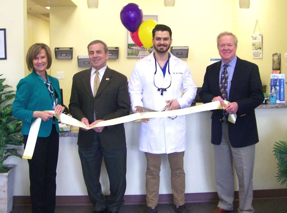 OPEN WIDE: From left, Quinnipiac Chamber of Commerce Executive Director Dee Prior-Nesti; North Haven First Selectman Mike Freda; Dr. Mahmoud Aruri, owner; and chamber board Chairman Tom Curtin at a ribbon-cutting March 25 for North Haven Dentists, 323 Universal Drive in North Haven. Aruri brings years of experience as a practicing dentist, according to a release. The facility offers general dentistry as well as a pediatric dental care program. Visit www.northhavendentists.com. Photo: Contributed Photo