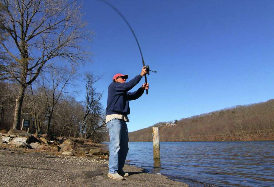 The state's water supply provides for many uses. Here a fisherman casts a line into the Housatonic River. Photo: Christian Abraham / Hearst Connecticut Media / Connecticut Post