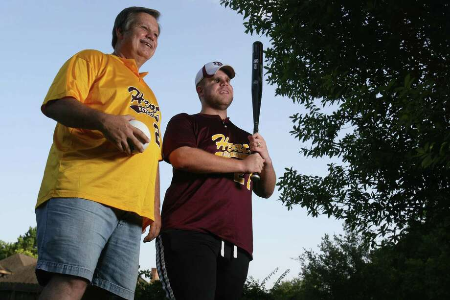 Blake Boudreaux, shown with his dad Charles in 2008, is among four Deer Park High School alumni who are this year's inductees into the Felton F. Waggoner Hall of Honor. Boudreaux is an advocate for the blind and hearing impaired and is a longtime supporter of beep baseball, in which the ball emits a sound that visually impaired players can hear. Photo: Mayra Beltran, Staff / Houston Chronicle / Houston Chronicle