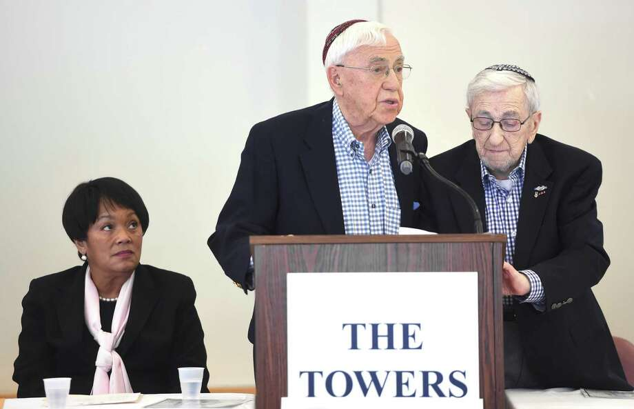 From left, New Haven Mayor Toni Harp listens to World War II veterans Norman Feitelson and Izzy Juda read the poem, We Remember Them, by Rabbi Sylvan Kamens and Rabbi Jack Riemer after the signing of a Holocaust Proclamation at The Towers in New Haven on March 7, 2019. Juda is a survivor of the Holocaust. Photo: Arnold Gold / Hearst Connecticut Media / New Haven Register