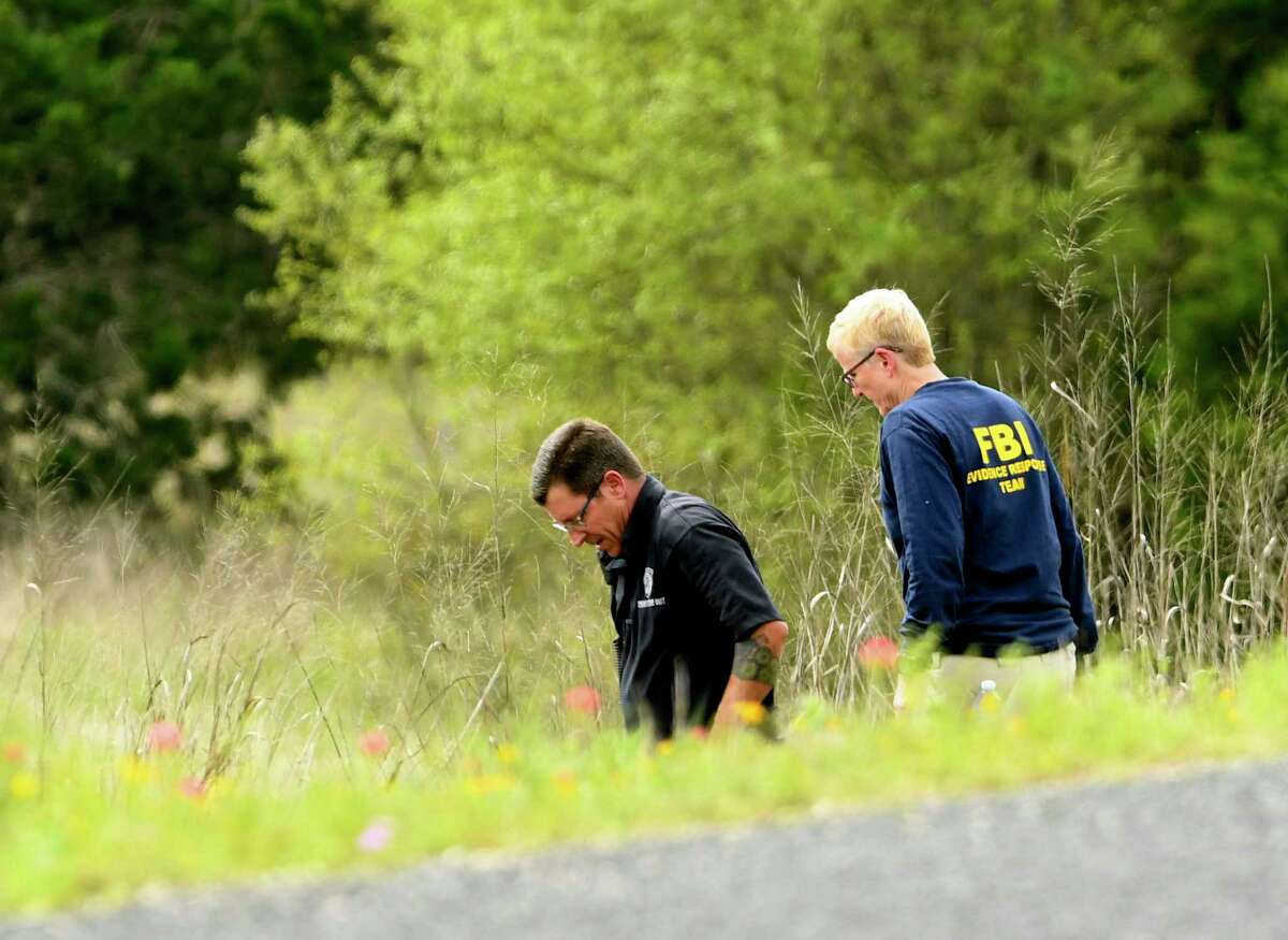 Federal and local investigators are at the scene off of Texas 211 on Friday, April 5, 2019, where charred remains were found on April 4. It is thought that the body might be that of businesswoman Andreen McDonald, who has been missing.