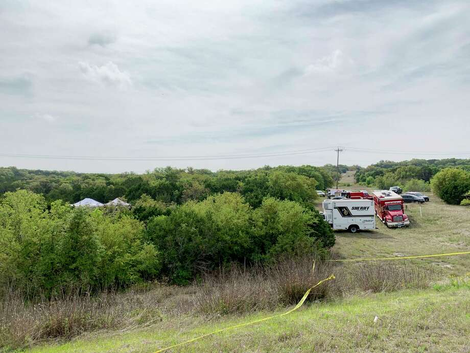 Federal and local investigators are at the scene off of Texas 211 on Friday, April 5, 2019, where charred remains were found on April 4. It is thought that the body might be that of businesswoman Andreen McDonald, who has been missing. Photo: Billy Calzada, Staff Photographer / San Antonio Express-News
