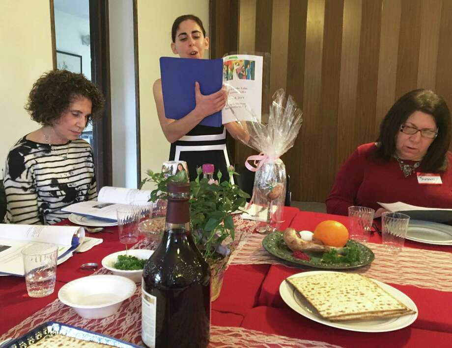 Cantor Laura Breznick reads at Temple Sholom's first women's seder in New Milford on Thursday. Photo: Katrina Koerting / Hearst Connecticut Media / The News-Times