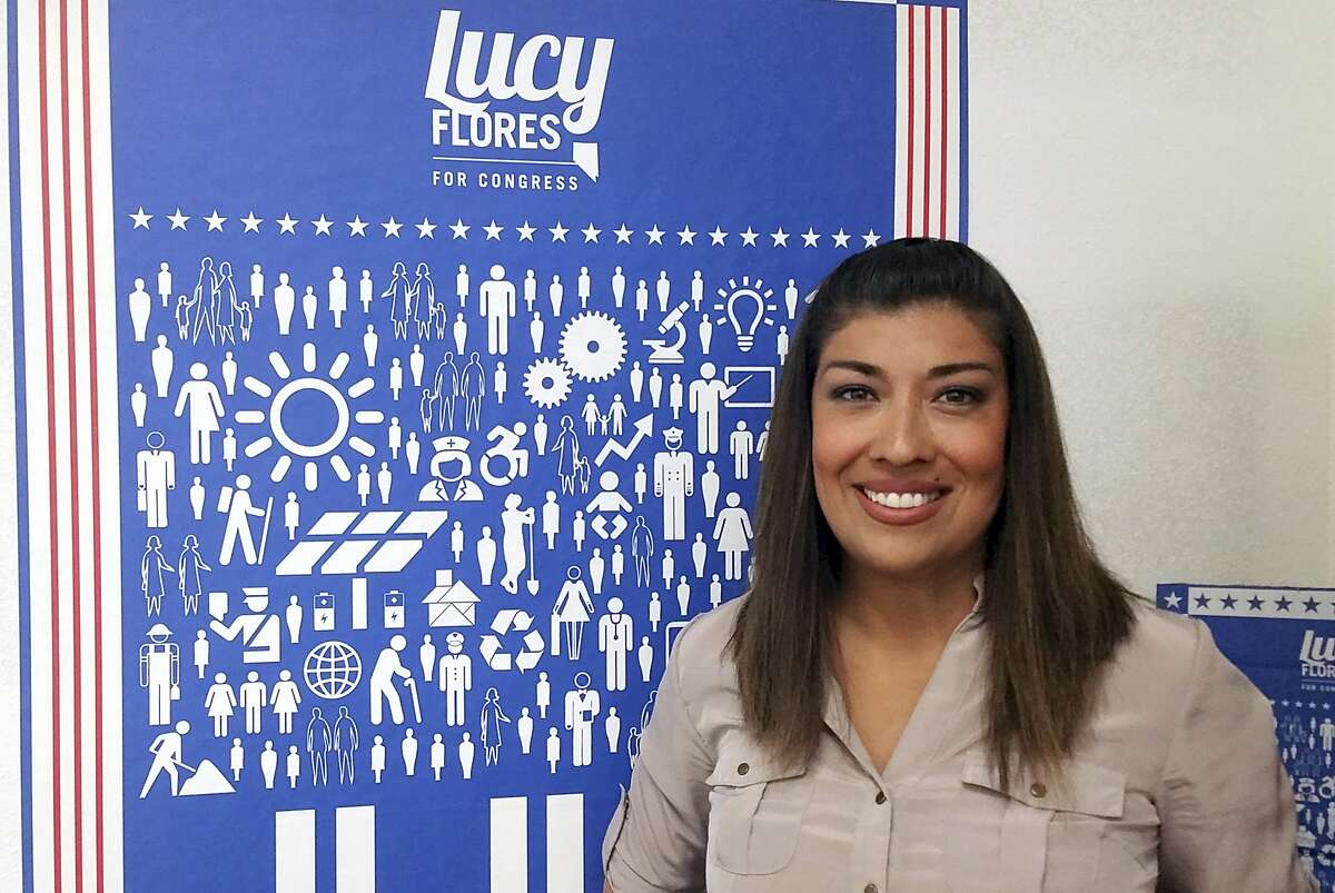 FILE - In this June 3, 2016, file photo, Lucy Flores poses for a photo at her North Las Vegas campaign headquarters. Flores, the former Nevada politician who accused Joe Biden of inappropriately kissing her on the back of the head in 2014, rose from a tough childhood through top Nevada political circles before becoming an outspoken critic about sexism and harassing behavior in politics.