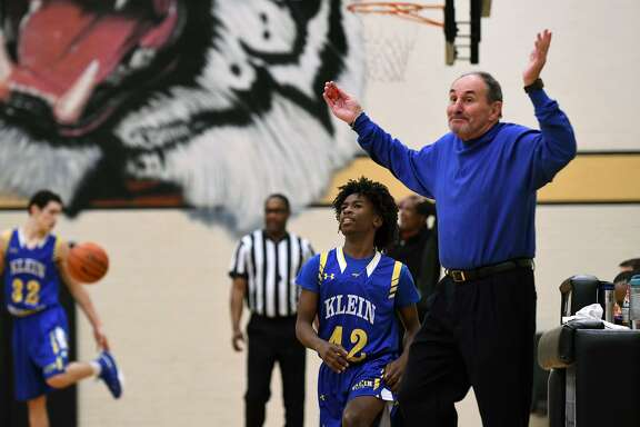 Klein Boys Head Basketball Coach Glen Arnold, right, with senior Aaron Black (42), resigns himself to a referee's call during the their matchup with Westfield at the 54th Annual Conroe Christmas Classic at Conroe High School on Dec. 28, 2018.
