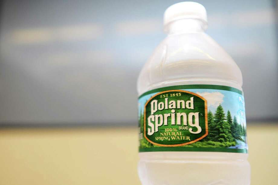 Nestle Waters North America has announced that it is converting its Poland Spring packaging to 100 percent recycled plastic. Photo: Michael Cummo / Hearst Connecticut Media / Stamford Advocate