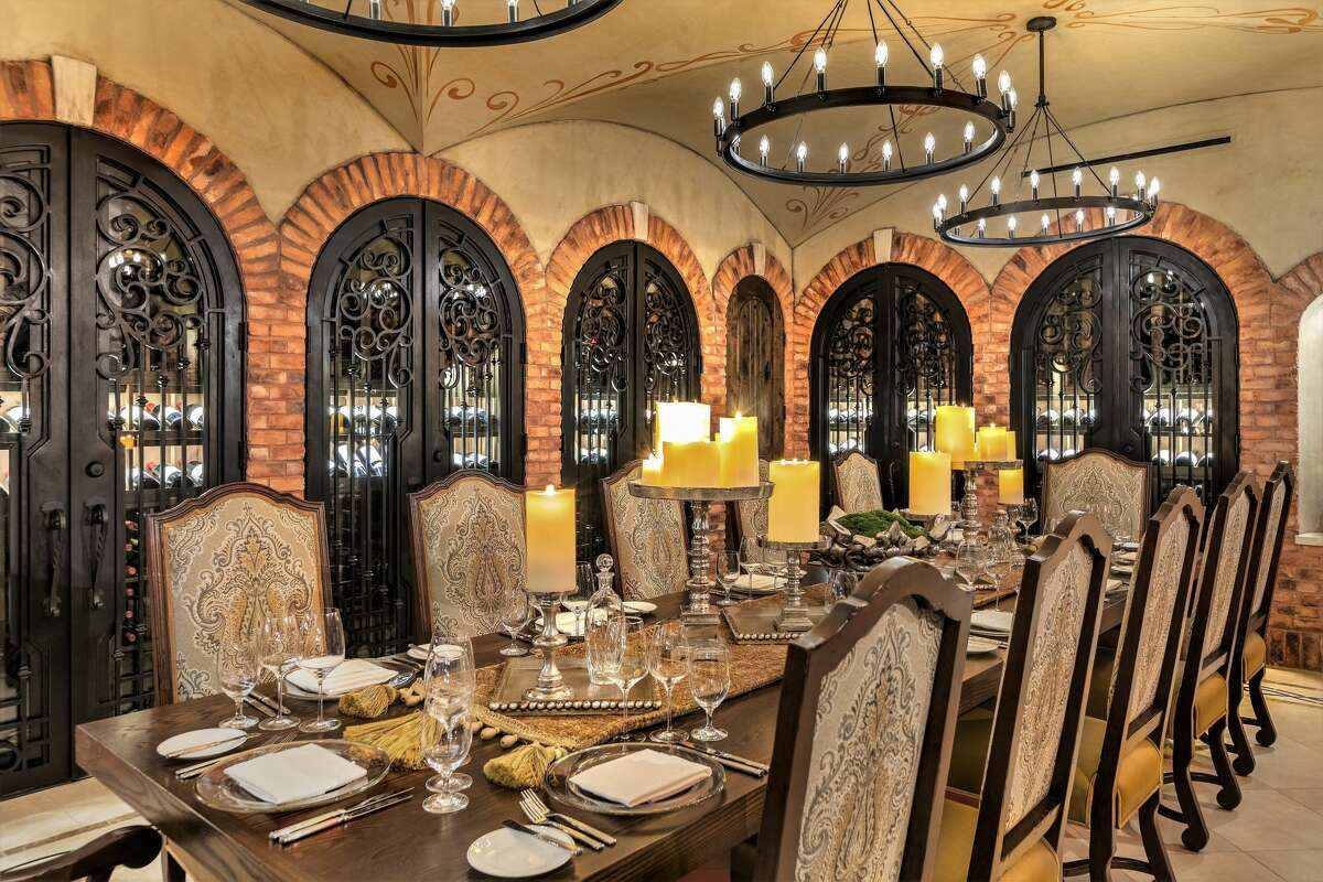 Designed to resemble a wine vault French Château or Tuscan Villa, the space is decked out with exposed brick, a cross-vault ceiling and glimmering chandeliers.