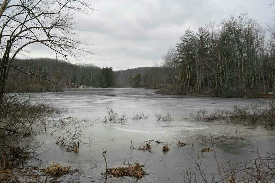 The eastern section of the Chestnut Ridge Reservoir, in Bethel. Bethel's public water system has violated a drinking water standard because of excessive trihalomethane, a byproduct of chlorine. Wednesday, February 17, 2016, in Bethel, Conn. Photo: H John Voorhees III / Hearst Connecticut Media / The News-Times