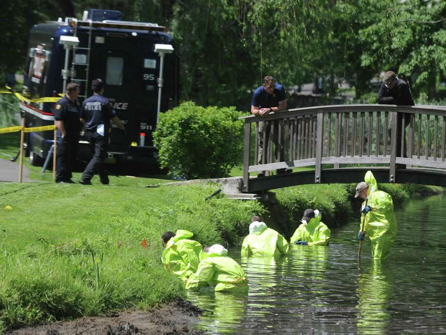 Investigators continue the investigation of found human remains by sweeping Binney Park in Old Greenwich, Conn. Thursday, June 8, 2017. Decomposed human remains were found in April 2017 at Helen Binney Kitchel Natural Park, located caddycorner to Binney Park and connected by a stream. Photo: Tyler Sizemore / Hearst Connecticut Media / Greenwich Time