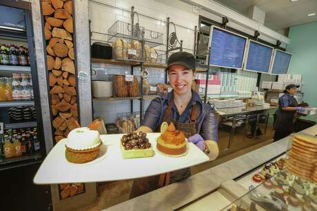 Common Bond Café & Bakery, 1706 Westheimer Rd., guest services, Haley Bernal shows a few of the entremets Thursday, April 4, 2019, in Houston.