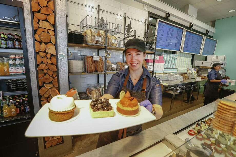 Common Bond Café & Bakery, 1706 Westheimer Rd., guest services, Haley Bernal shows a few of the entremets Thursday, April 4, 2019, in Houston. Photo: Steve Gonzales, Houston Chronicle / Staff Photographer / © 2019 Houston Chronicle