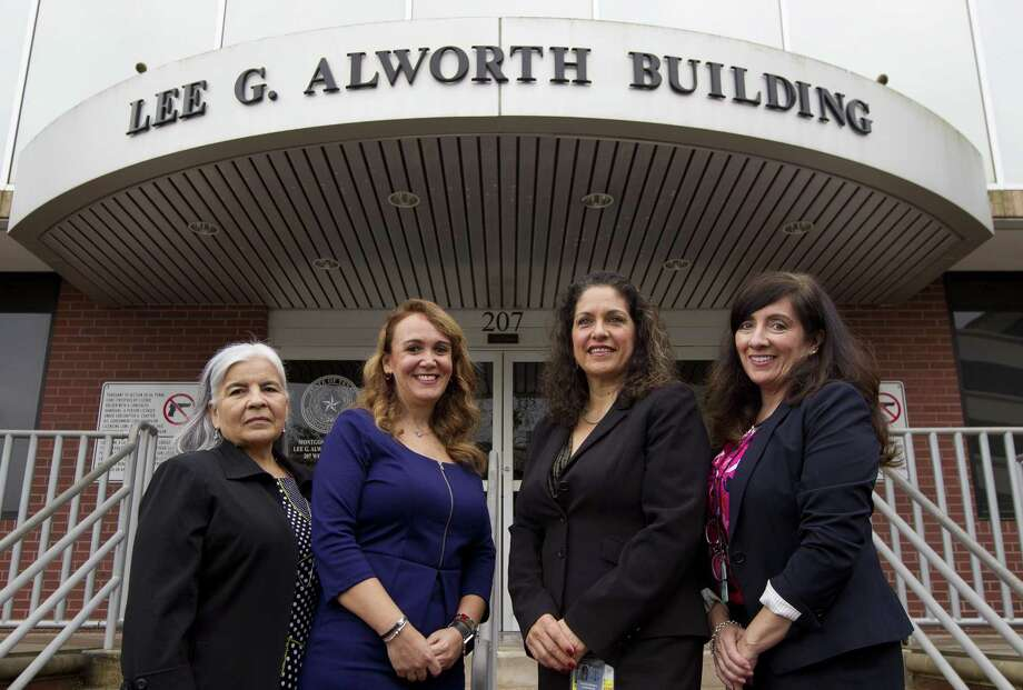 Court interpreters Elsa Sanchez, Ana Gallardo, Monica Cejudo and Doris Foulkes pose for a portrait outside the Lee. G. Alworth Building where they aid Spanish-speaking inmates in various district courts proceedings, Thursday, April 4, 2019, in Conroe. Photo: Jason Fochtman, Houston Chronicle / Staff Photographer / © 2019 Houston Chronicle