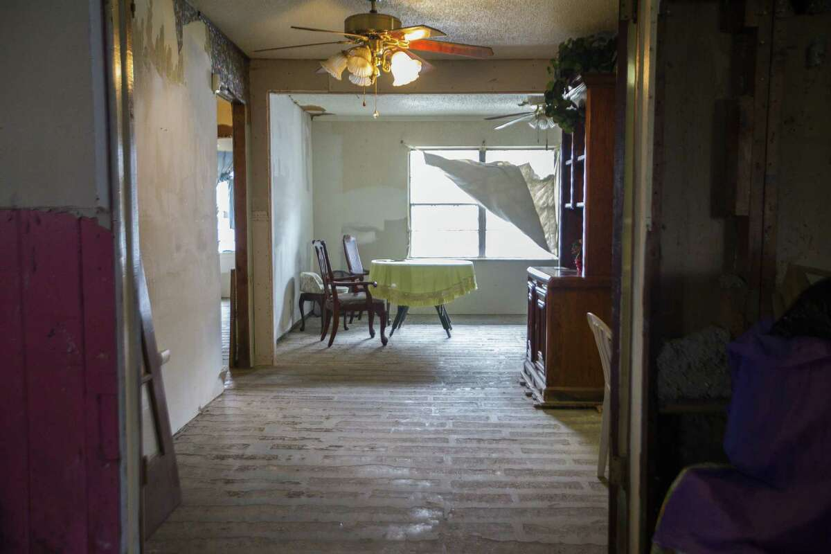 Annie Green's home in northeast Houston was severely damaged by Harvey and remains in a state of disrepair in this photo taken Jan. 15, 2019. Green is among thousands of Houstonians trying to get help to repair their homes through the city's Harvey recovery fund.