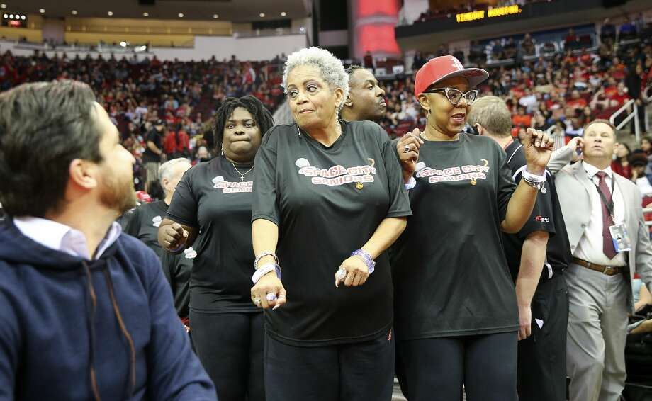 Sylvia Brown, 70, gets ready for her first time performing with the Space City Seniors during the Houston Rockets time out. Photo: Elizabeth Conley/Staff Photographer