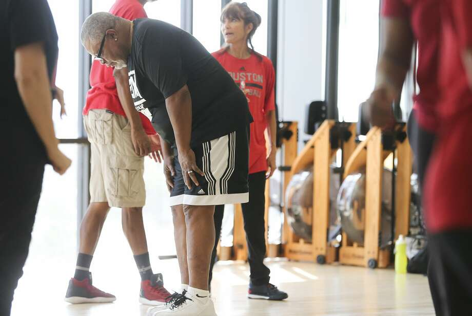 Alvin Adams takes a break during practice. Adams says the Space City Seniors helps keep him moving and get his exercise in. Photo: Elizabeth Conley/Staff Photographer