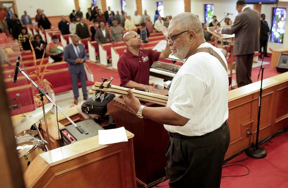 Alvin Adams plays the bass at the church he attends. This is Adams second year with the Space City Seniors. Photo: Elizabeth Conley/Staff Photographer