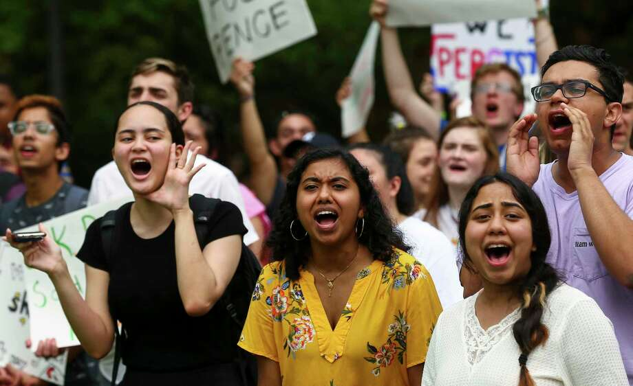 Rice University students chant in protest as Vice President Mike Pence arrived in his motorcade at Baker Hall building, where he delivered remarks about Venezuela at Rice University's Baker Institute for Public Policy Friday, April 5, 2019, in Houston. Photo: Godofredo A Vásquez, Staff Photographer / © 2019 Houston Chronicle