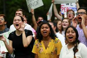 Rice University students chant in protest as Vice President Mike Pence arrived in his motorcade at Baker Hall building, where he delivered remarks about Venezuela at Rice University's Baker Institute for Public Policy Friday, April 5, 2019, in Houston.