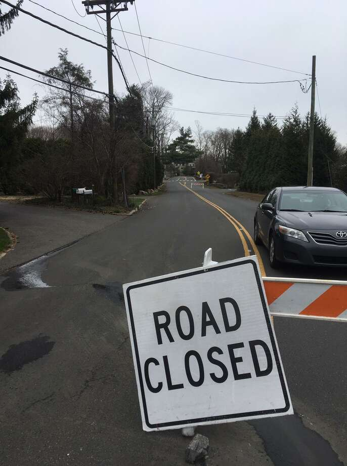 Fairfield Road in Greenwich is closed Friday between Old Church and Hillside roads while a water main is repaired. Photo: Robert Marchant / Hearst Connecticut Media