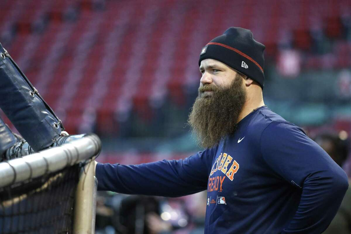 Houston Astros Evan Gattis watches batting practice as the Astros worked out at Fenway Park, Friday, October 12, 2018, in Boston , in preparation for Game 1 of the ALCS against the Boston Red Sox.