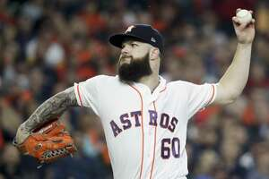FILE - In this Oct. 16, 2018, file photo, Houston Astros starting pitcher Dallas Keuchel throws against the Boston Red Sox during the first inning in Game 3 of a baseball American League Championship Series in Houston. Keuchel, Bryce Harper, Manny Machado and Craig Kimbrel will not be around when the bat and ball bags are opened at spring training throughout Florida and Arizona this week. They are among the dozens of free agents still looking for jobs. (AP Photo/David J. Phillip, File)