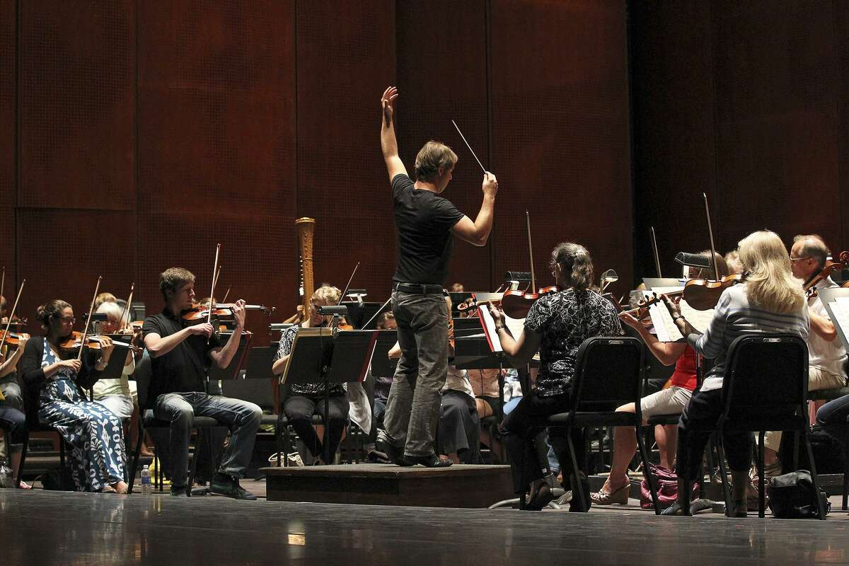 Music director Sebastian Lang-Lessing leads as the San Antonio Symphony rehearses at the Tobin Center for the Performing Arts in 2014.