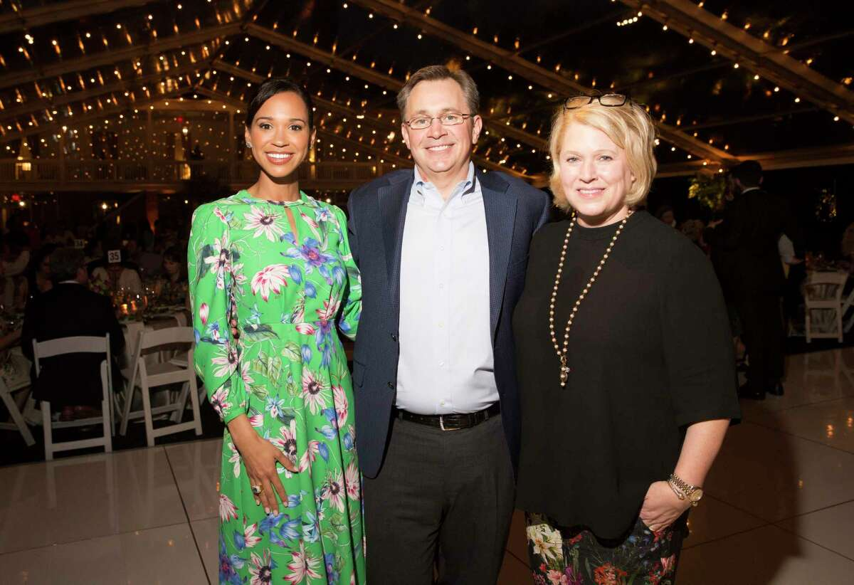 The 25th Annual Trees for Houston Root Ball Emcee Mia Gradney and Shawn and Bill Jackson pose for a photograph at The Bayou Club on Thursday, April 4, 2019, in Houston.
