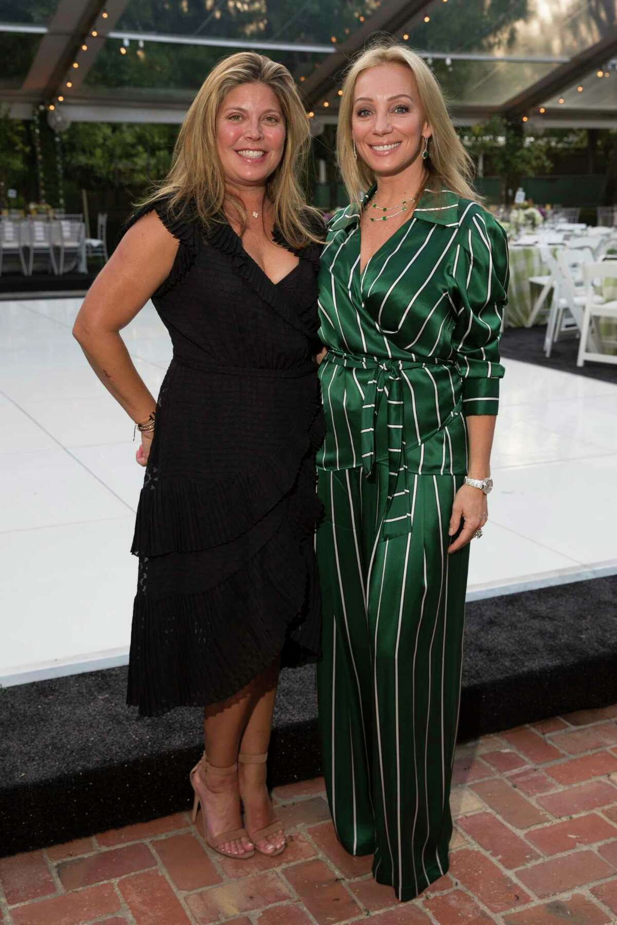 Lori Shellist, left, Brandy Benditz and pose for a photograph at the 25th Annual Trees for Houston Root Ball at The Bayou Club on Thursday, April 4, 2019, in Houston.