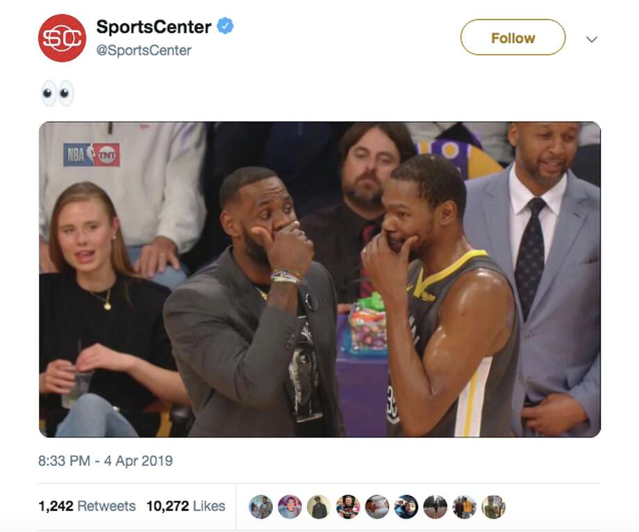 04dee8242db0 Kevin Durant and LeBron James chat with their hands over their mouths  during the Warriors