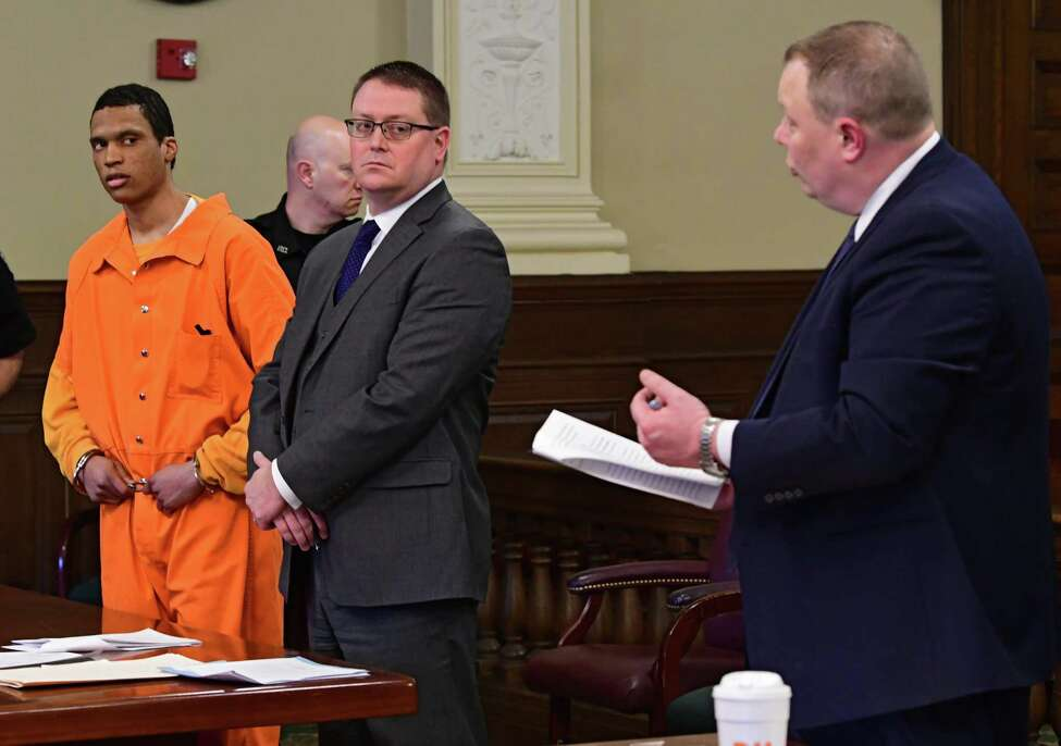Chief Assistant District Attorney Matthew Hauf, right, asks Justin Mann, left, questions as Mann pleads guilty to four counts of second degree murder for the December 2017 quadruple homicide in Lansingburgh in Rensselaer County Court on Friday April 5, 2019 in Troy, N.Y. Defense attorney Joseph Ahearn stands next to Mann. (Lori Van Buren/Times Union)