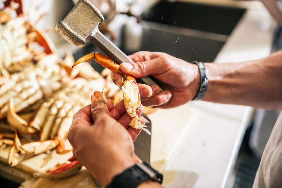 Marino Peradotto deshells a crab leg during service at Swan Oyster Depot in San Francisco, Calif. on Tuesday, April 2, 2019. Photo: Stephen Lam, Special To The Chronicle