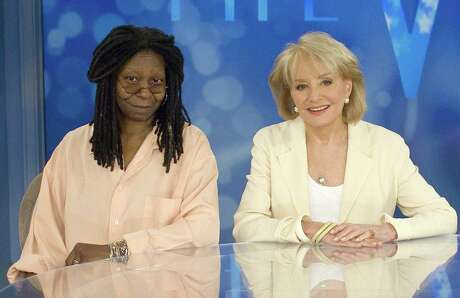 """Oscar-winning actress Whoopi Goldberg (L) joins """"The View"""" creator and co-host Barbara Walters in this publicity photo released to Reuters August 1, 2007. Walters announced that Goldberg has been chosen to fill the vacancy left by Rosie O'Donnell as moderator of the morning talk show and will start in September. REUTERS/Steve Fenn/ABC/Handout (UNITED STATES). EDITORIAL USE ONLY. NOT FOR SALE FOR MARKETING OR ADVERTISING CAMPAIGNS. NO ARCHIVES. NO SALES."""