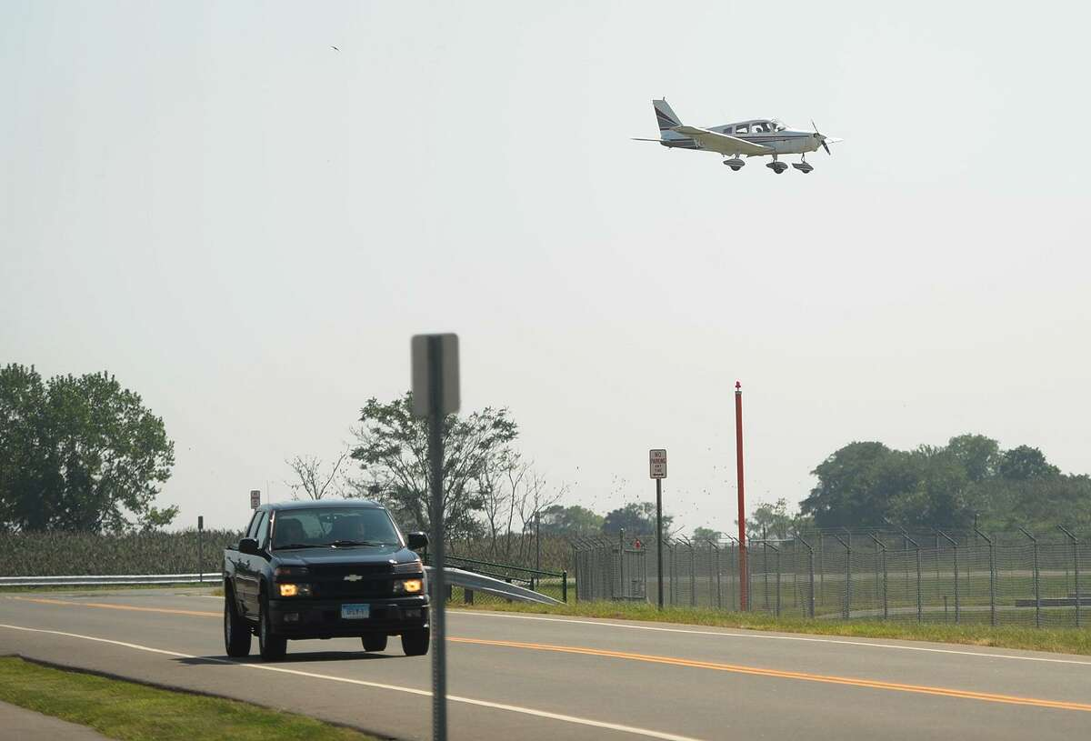 A small plane crosses Main Street to land at Sikorsky Airport in Stratford, Conn. on Wednesday, August 29, 2018.
