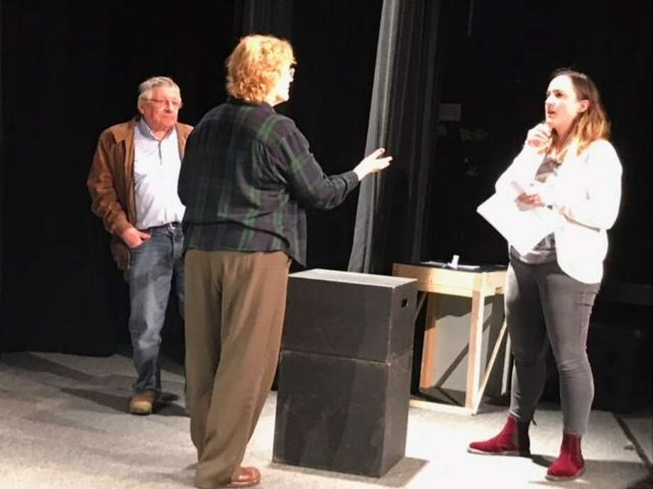 "Norman Allen, left, director Melody James and Gina Pulice rehearse a scene in ""Meet Me in the Lobby,"" a piece by Laura Thoma that's one of nine plays in the Theater Artists Workshop 2019 Spring Festival of New Works, running April 26-28 in Norwalk. Photo: Laura Thoma / Contributed Photo"