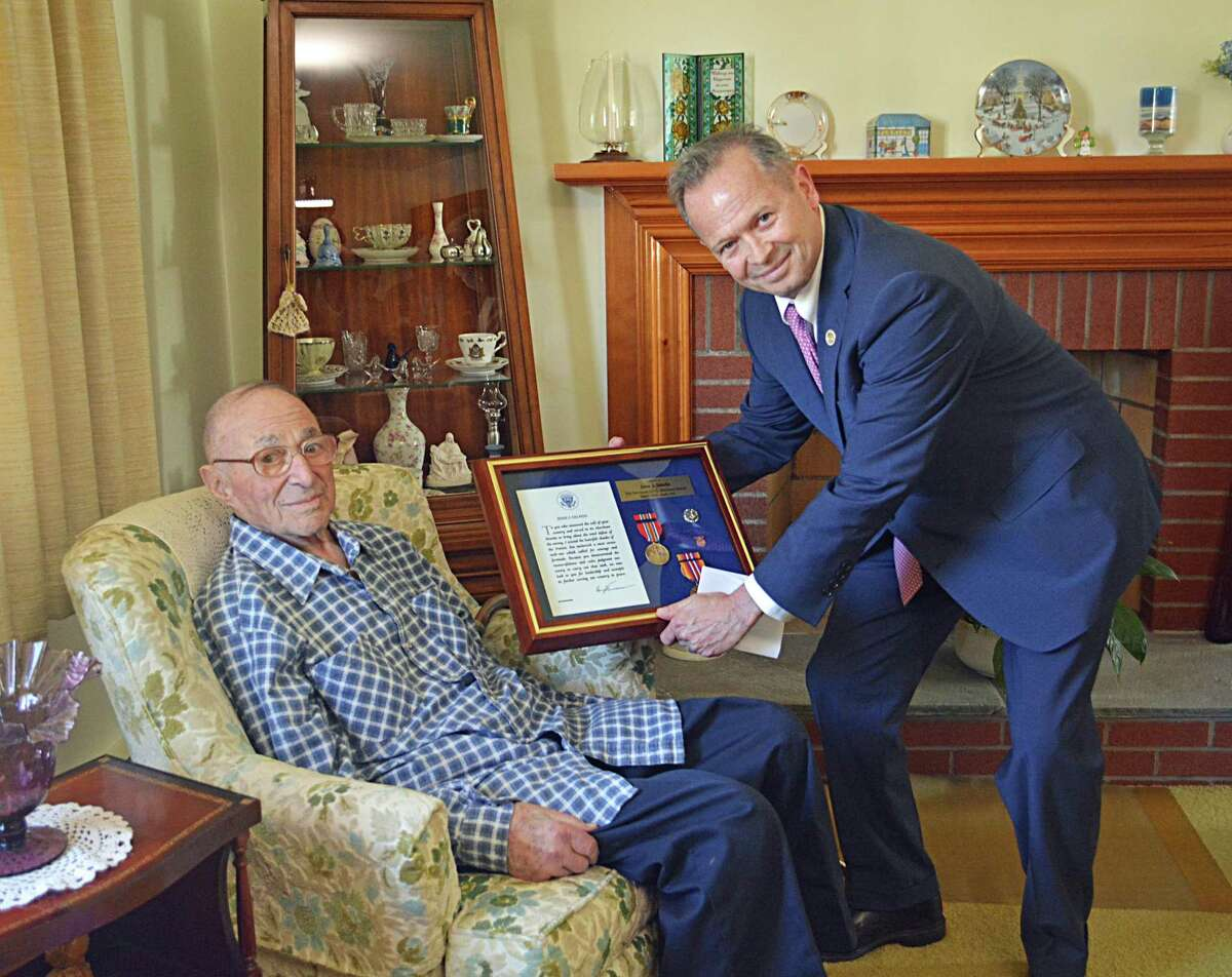 Five-decade-long councilman and WWII vet Jesse Salafia, 105, a 69-year member of the American Legion Post 75 in Middletown and U.S. Merchant Marine, was visited Thursday afternoon by a group of state and U.S. officials for his countless achievements and various roles serving the public.