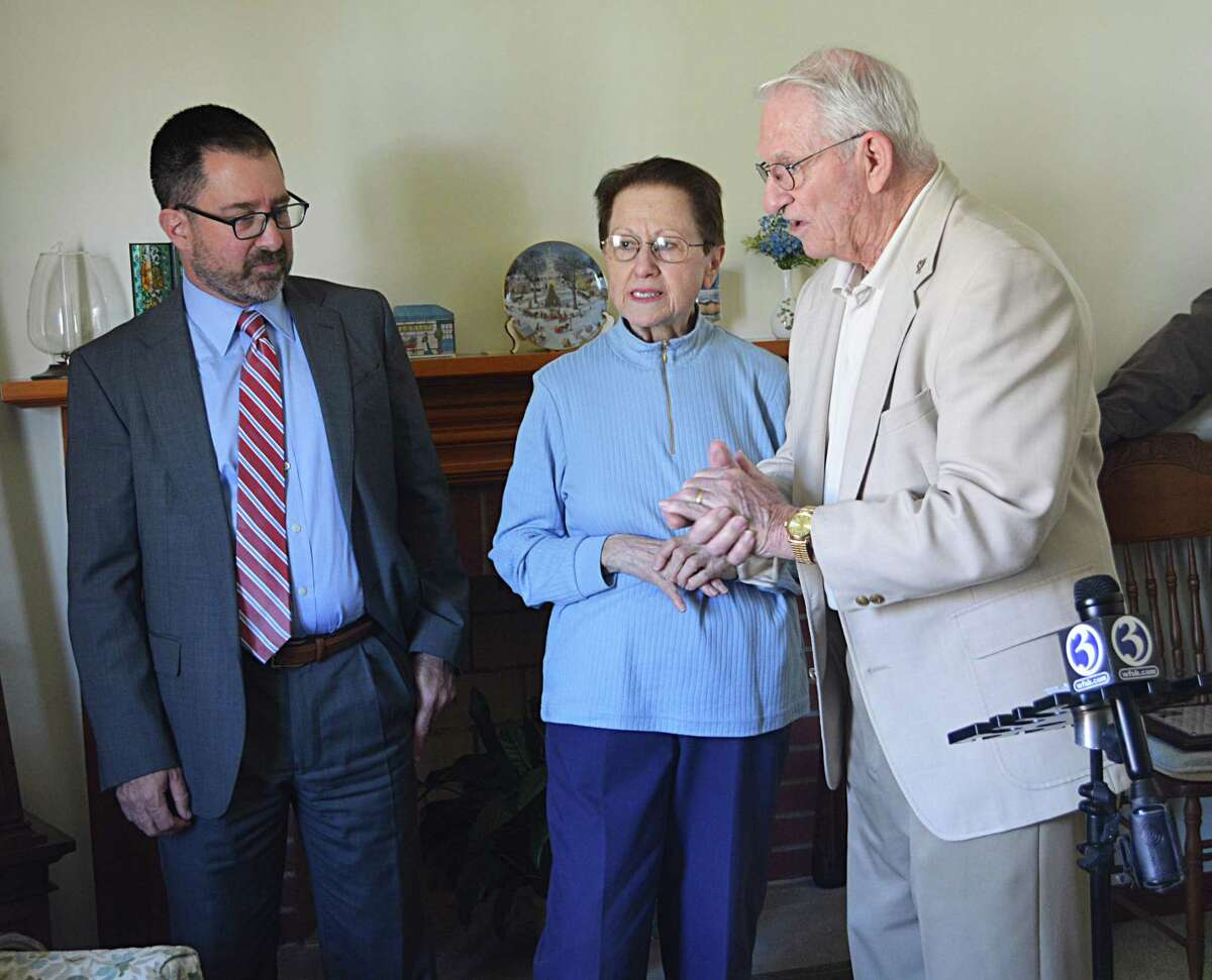 WWII vet Jesse Salafia of Middletown was lauded for his innumerable contributions to the city and nation Thursday. Shown here, from left, are his grandson Brett Salafia, his wife of 60 years, Ann; and David Darling, South Fire District commissioner.