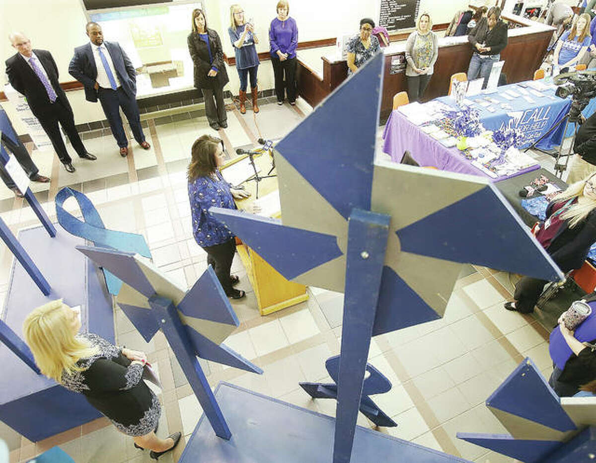 Framed by pinwheels, Tarra Winters, from Prevent Child Abuse Illinois was one of the speakers at this year's event to kick off Child Abuse Prevention Month in the Madison County Administration Building in Edwardsville.
