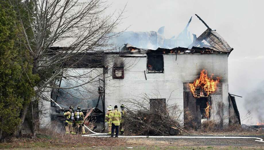 North Haven firefighters battle a blaze at 95 Warner Road in North Haven on April 5, 2019. Photo: Arnold Gold / Hearst Connecticut Media / New Haven Register